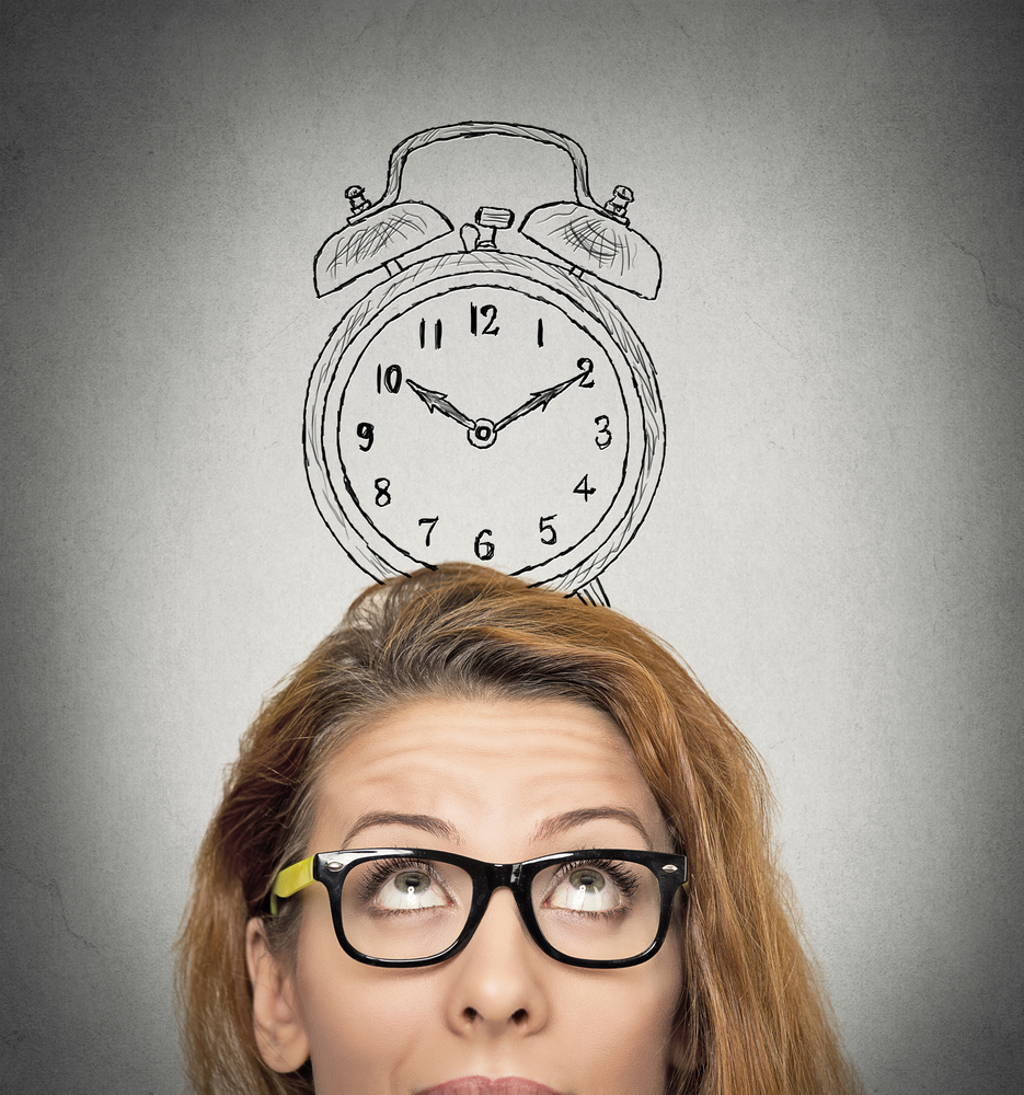 closeup headshot young business woman with alarm clock drawing sketch above her head, isolated grey wall background. Human face expressions, emotions. Time, punctuality, busy schedule concept-1