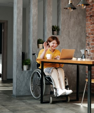 Woman in wheelchair talking on video chat